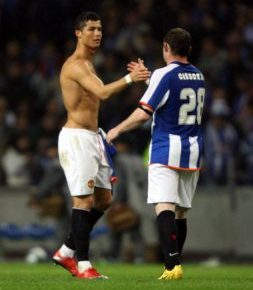 A picture of Cristiano Ronaldo embracing a Porto player for Manchester United in a Champions League quarter final in Portugal in 2009