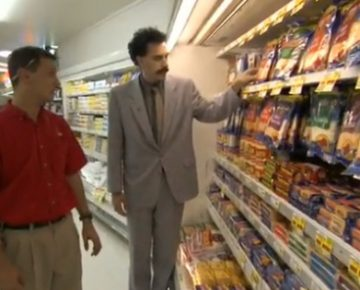 Two men looking at frozen product in a supermarket