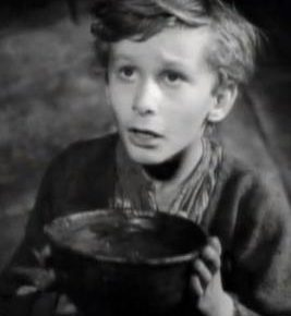 A still from the 1948 Oliver Twist film, depicting the protagonist holding a bowl