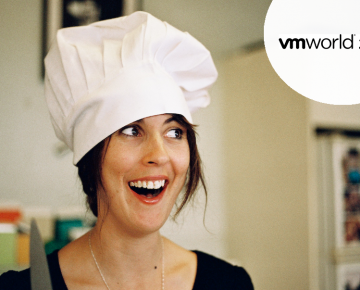 A photo of a woman in a chef's hat smiling