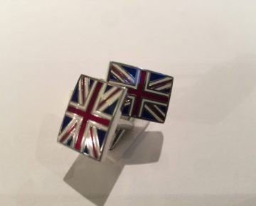 A pair of cufflinks in the form of the UK flag