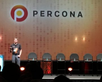 A speaker on stage at Percona Live 2017